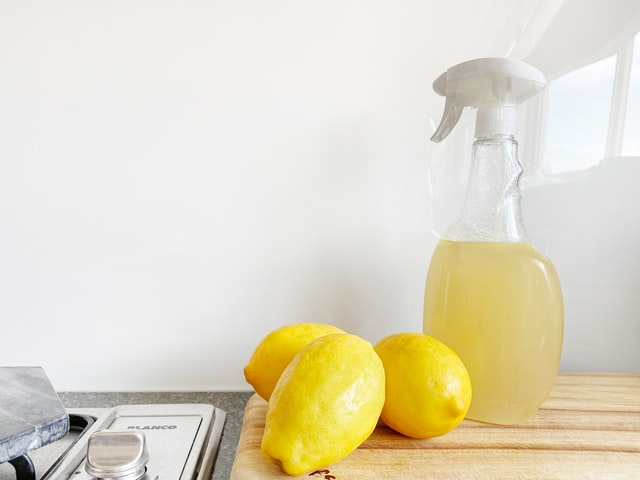 Homemade cleaner made with lemons in a bottle.